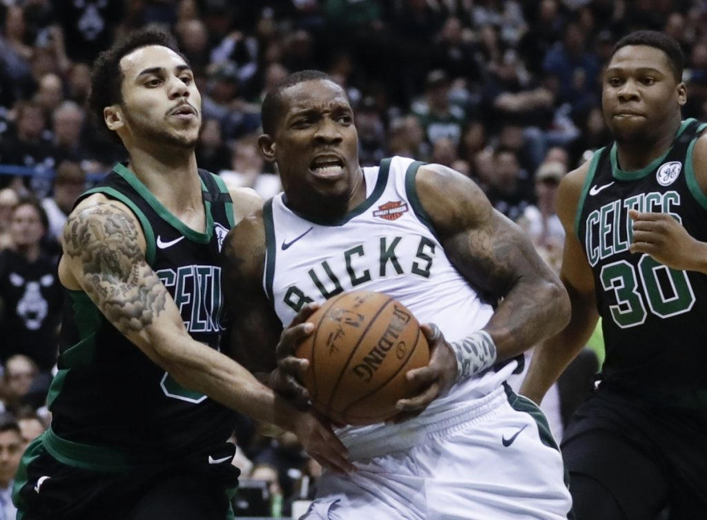 Milwaukee's Eric Bledsoe is fouled by Boston's Shane Larkin during the first half of Game 4 of a first-round playoff series Sunday in Milwaukee.