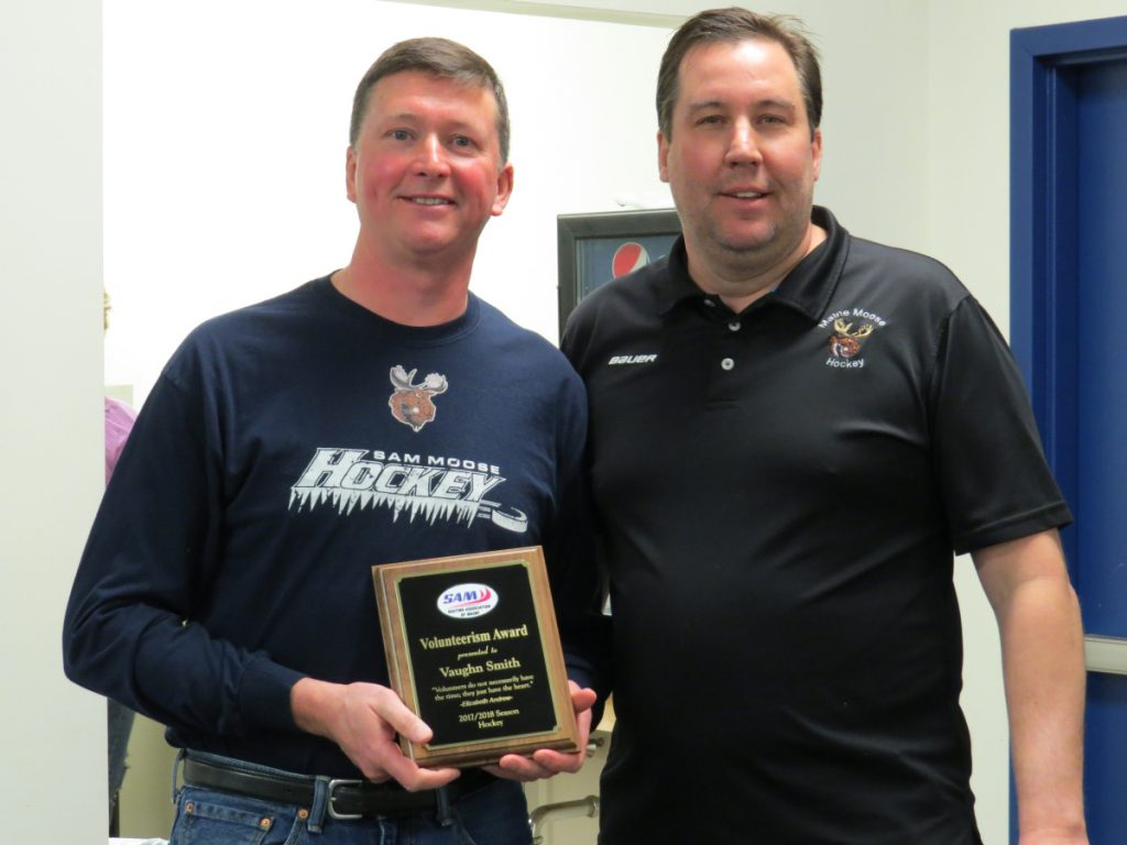 An outstanding volunteerism award was presented to SAM hockey representative and long-time head coach Vaughn Smith, left, from West Gardiner, by Dan Foster, chair of the hockey committee during the annual meeting at the Camden National Bank Ice Vault in Hallowell.