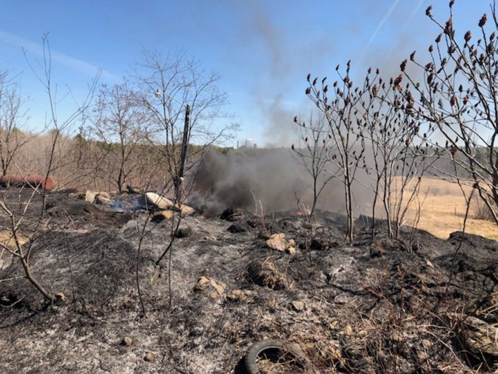 A stubborn tire fire burns Monday on Middle Road in Skowhegan, just 1.5 miles from the Sappi North America paper mill pictured in the background.