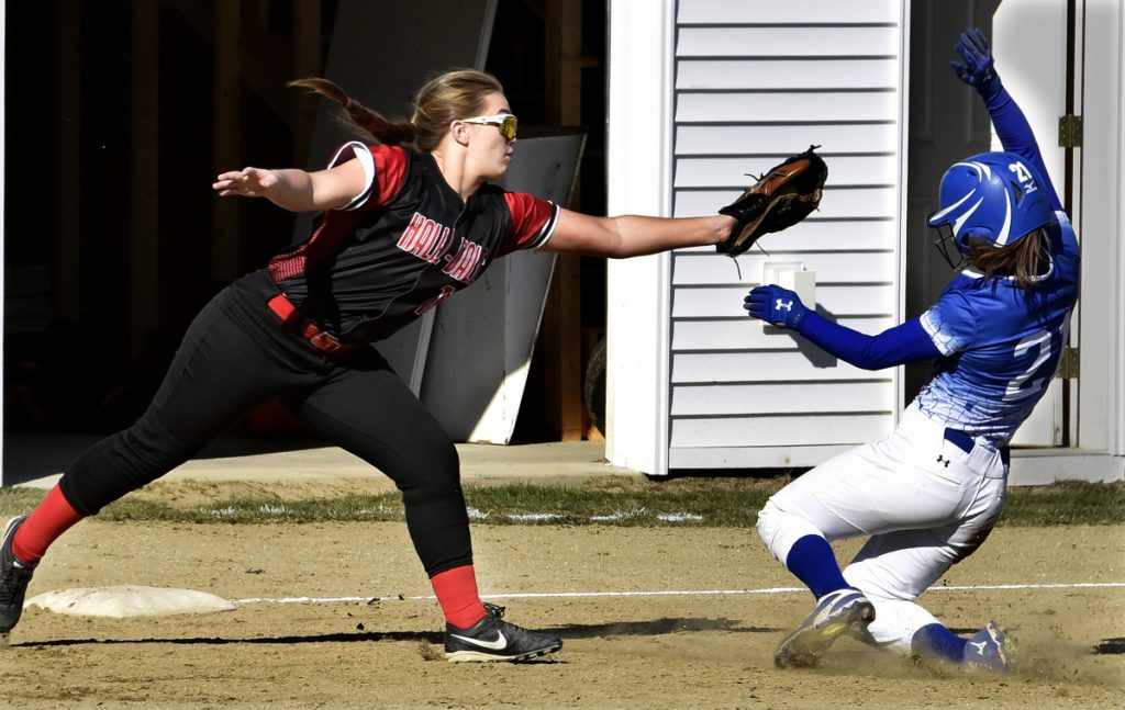 Madison runner Jordyn Wheeler slides into third base as Hall-Dale's Bella Marino tries to apply the tag during a Mountain Valley Conference game Monday in Farmingdale.