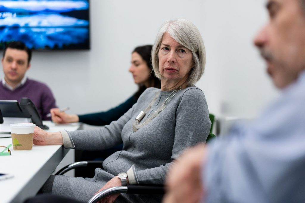 Rebecca Corbett, Colby College class of 1974, confers with colleagues at The New York Times during a recent news meeting.