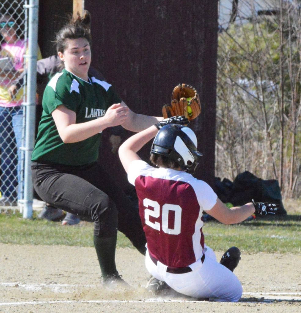 Rangeley starting pitcher Sydney Royce watches as Richmond's Paige Lebel (20) scores on a wild pitch during an East-West Conference game Tuesday in Richmond. The Bobcats rolled to a 14-0 win.