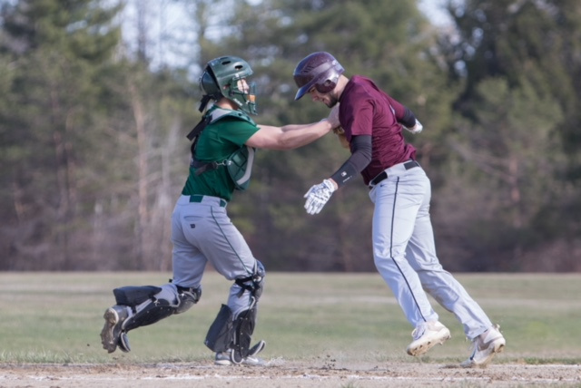 Richmond runner Matt Rines is tagged out at home by Rangeley catcher Zach Trafton during a game Tuesday in Richmond.