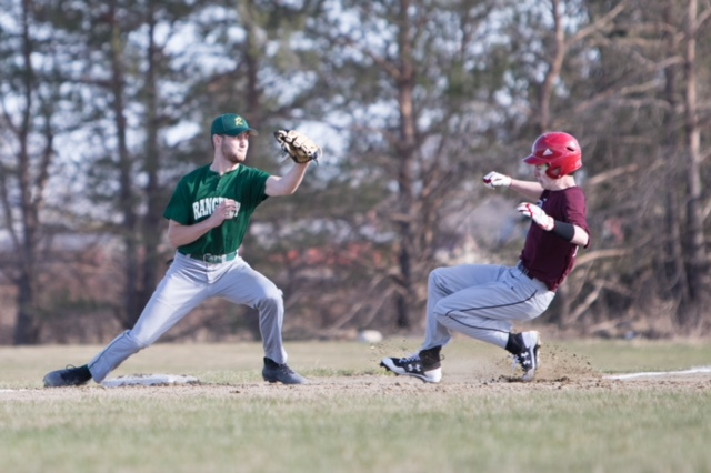 Richmond runner Andrew Vachon slides safely into third base as Rangeley's Cal Crosby tries to make a play during a game Tuesday afternoon at Richmond High School.