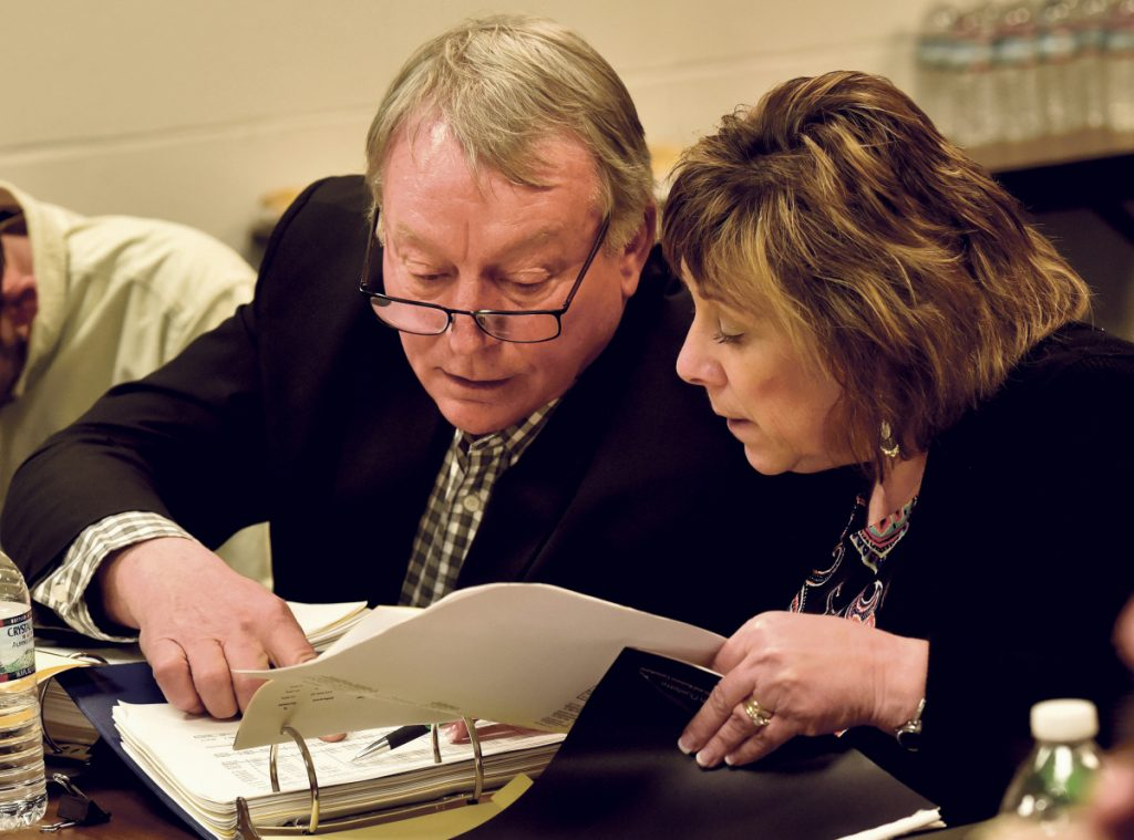 AOS 92 Superintendent Eric Haley confers about budget figures with Finance Director Paula Pooler during a March 19 meeting with the Winslow Town Council.