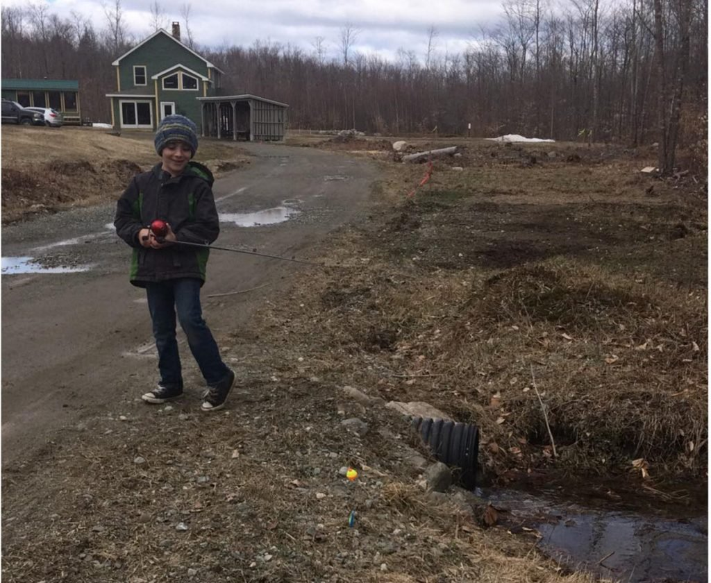 Joshuah Waugh, 8, of Canaan, works on his fishing skills in his driveway.