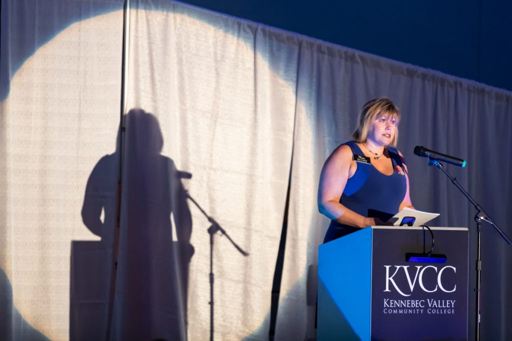 Kimberly Lindlof, president and CEO of the Mid-Maine Chamber of Commerce, welcomes the crowd of 250 attendees Thursday night at Kennebec Valley Community College during the opening of the awards ceremony in Fairfield.