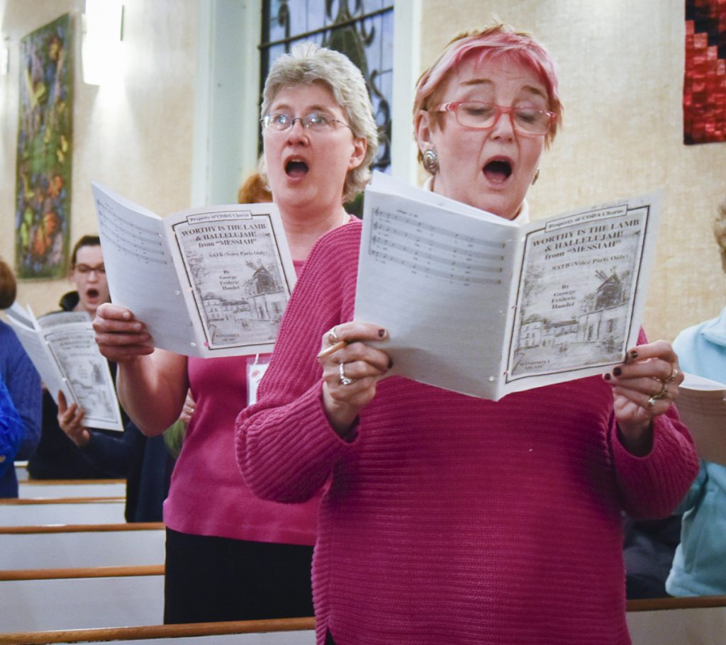 """CODA Chorus board president Ruth Lund, left, of Readfield, and Su Locsin, of Augusta, sing the soprano part in George Frideric Handel's """"Worthy of Lamb"""" at a rehearsal Monday at the Winthrop United Methodist Church. The chorus plans to present its 50th anniversary jubilee concert this Saturday at Hope Baptist Church in Manchester."""