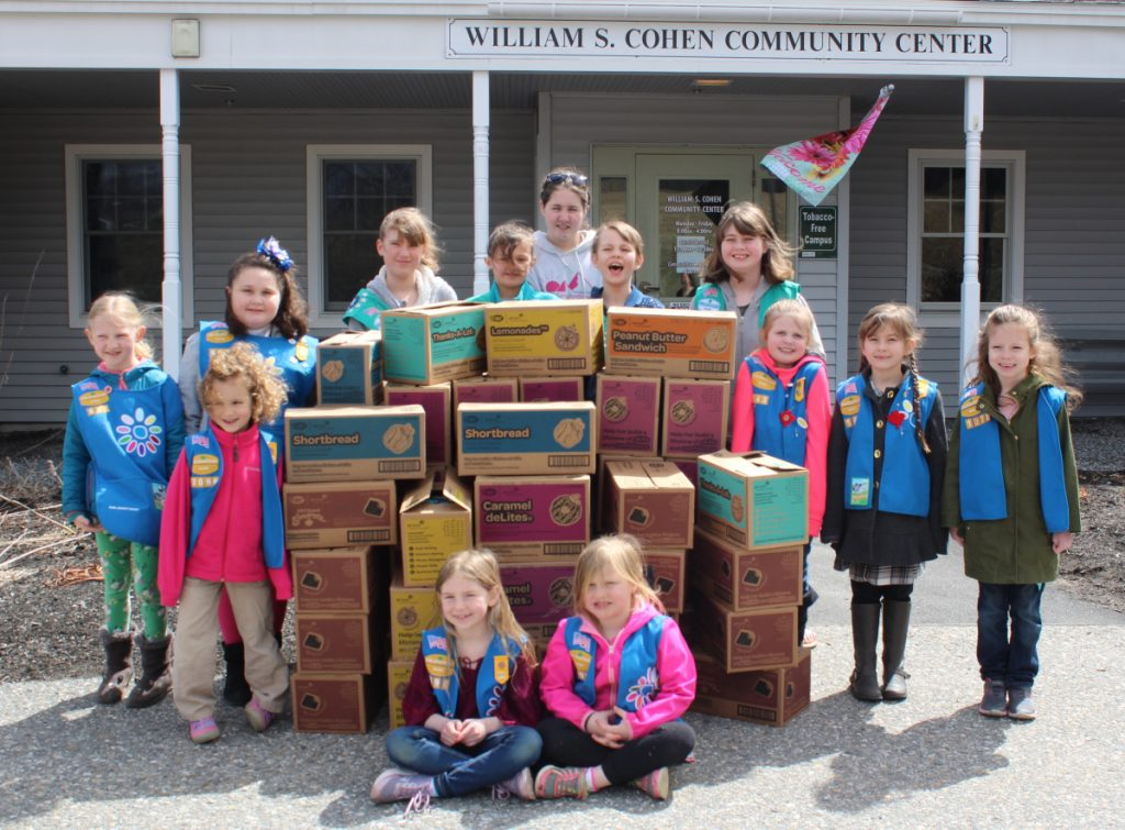 Girl Scouts  from the Cobbossee Service Unit recently delivered more than 50 cases of donated cookies to the Meals on Wheels program at Spectrum Generations Cohen Community Center in Hallowell. In front, from left, are: Freya Carlson,Troop 696; and Delia Colfer-Troop 696 In back, from left, are: Nora Setchell, Troop 697; Caroline Heck, Troop 2096; Madilynn Irish, Troop 697; Ashlyn Fortin, Troop 753; Ella Setchell, Troop 753; Haley McGrath, Troop 2146; Cadence Smith, Troop 753; Sandi Bolick, Troop 880; Louiselle Marshall, Troop 143; Scarlett Pollard, Troop 143; and Clara Clark, Troop 1075.