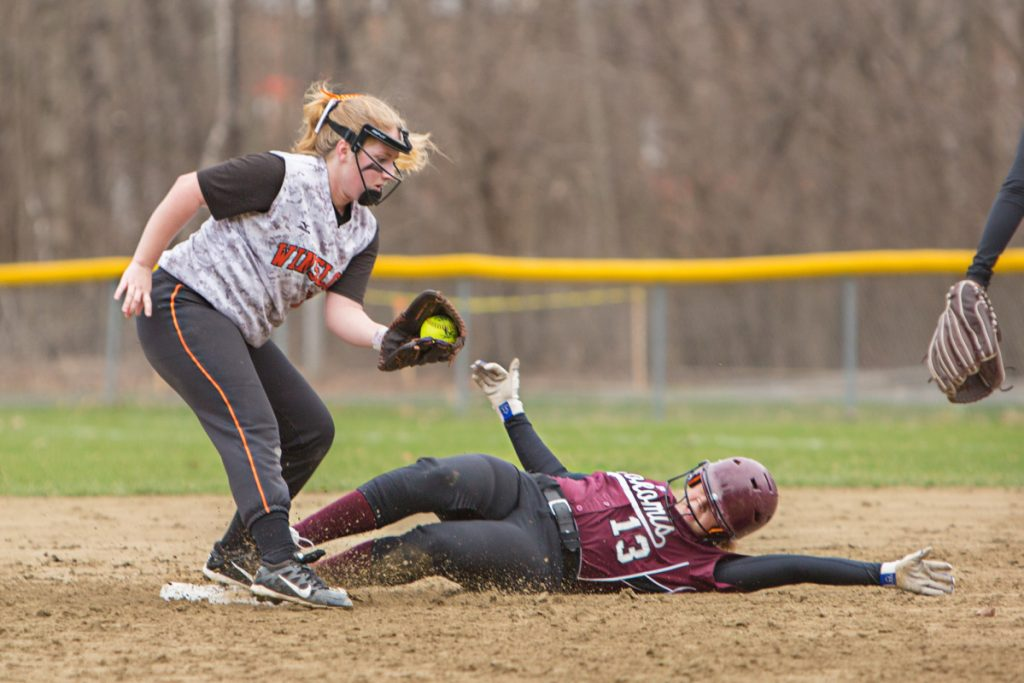 Winslow second baseman Ashley LaChance takes the throw as Nokomis runner Maci Leal slides into second base during a game Friday in Winslow.