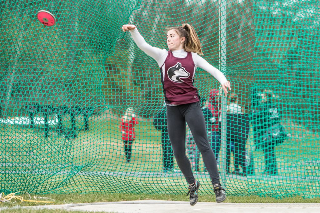 Photo by Jennifer Bechard   MCI's Allison Hughes throws the disc at the Husky Throwdown on Saturday in Pittsfield.