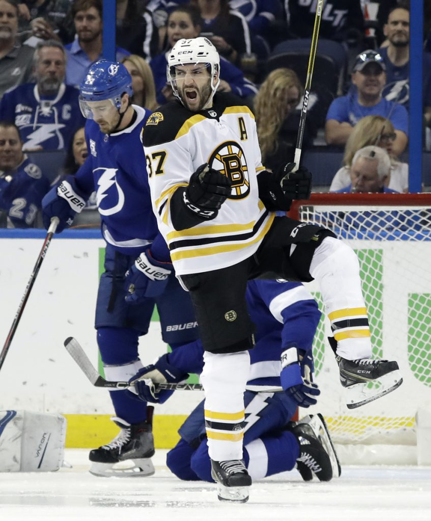 Boston center Patrice Bergeron (37) celebrates his goal against Tampa Bay during the second period of Game 1 of a second-round playoff series Saturday in Tampa, Florida.