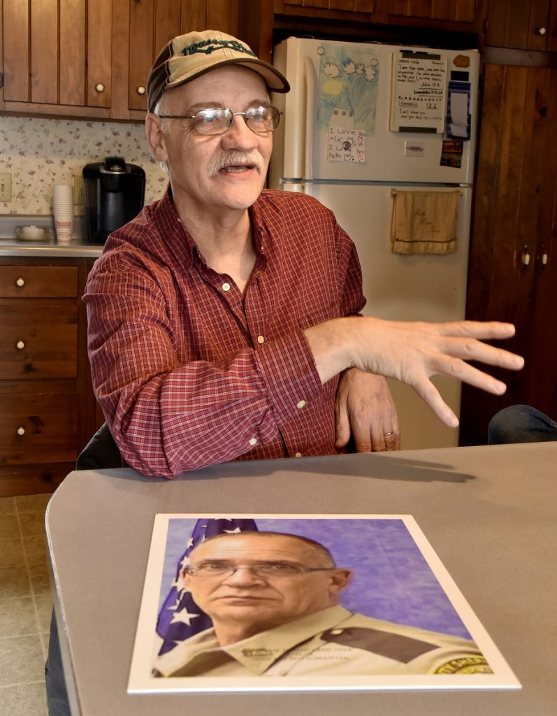 Tom Cole, brother of slain Somerset County Deputy Cpl. Eugene Cole, in photograph, talks with pride about his brother in Skowhegan on Sunday.