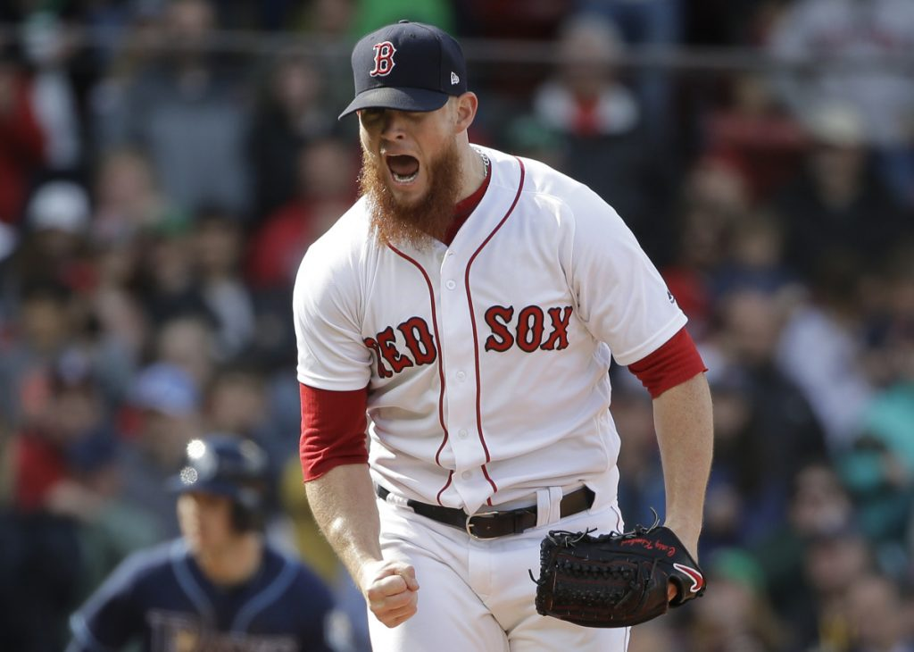 Boston's Craig Kimbrel celebrates after striking out Tampa Bay's Carlos Gomez to end the game Sunday, in Boston.