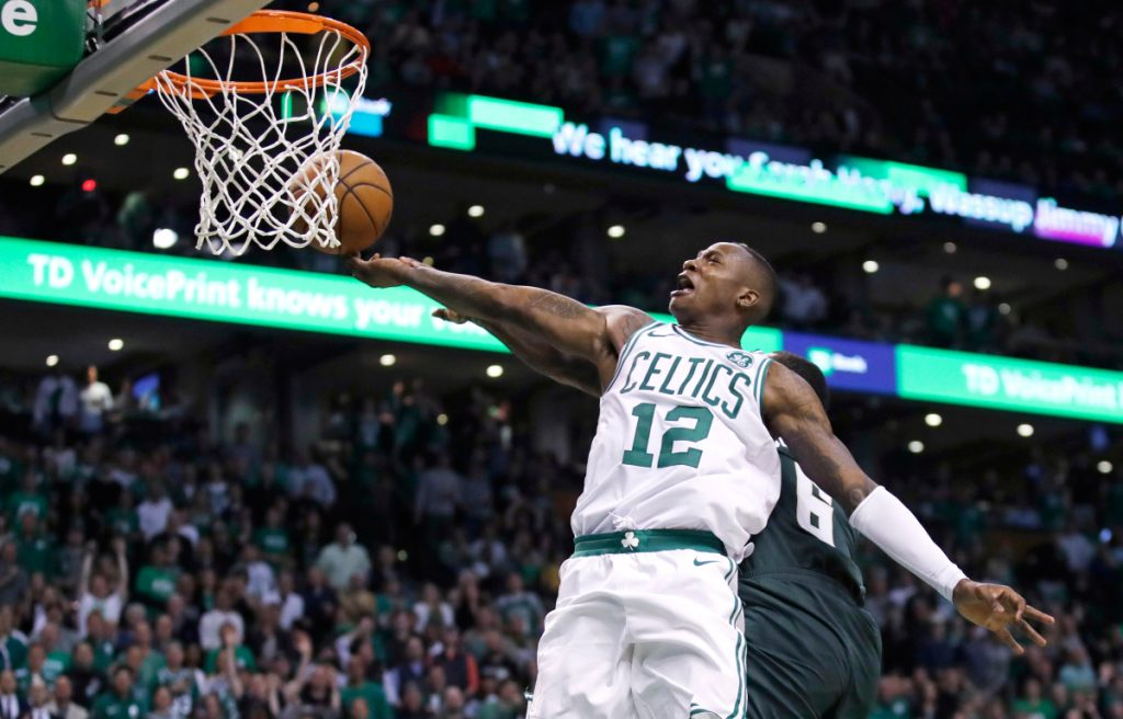 Boston's Terry Rozier (12) drives to the basket against Milwaukee during the fourth quarter of Game 7 of a first-round playoff series Saturday in Boston. Rozier scored 26 points in the Celtics' 112-96 win.