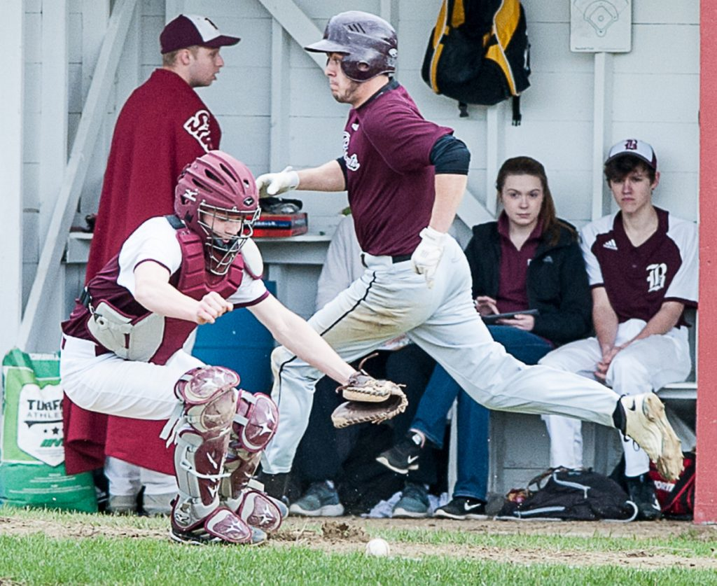 Richmond's Zach Small scampers home to score a run after Buckfield catcher Cole Merrill had difficulties with the throw to the plate during Monday's game in Buckfield.