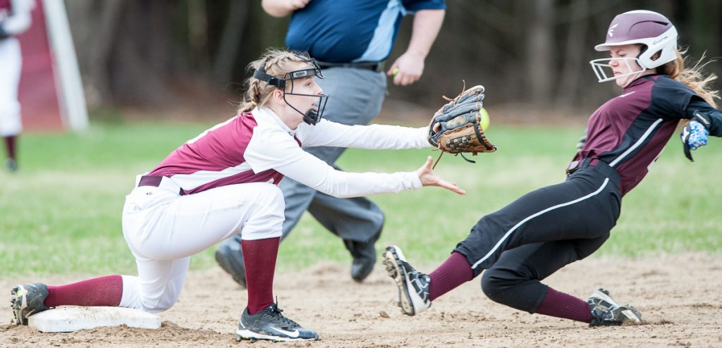 Sun Journal by Russ Dillingham Buckfield's Maggie Bragg slides into second safely before Richmond's Caitlin Kendrick can put the tag on her during Monday's game in Buckfield.