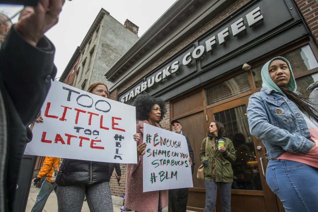 "Protesters gather outside of a  Starbucks in Philadelphia on Sunday, where two black men were arrested Thursday after employees called police to say the men were trespassing. The arrest prompted accusations of racism on social media. Starbucks CEO Kevin Johnson posted a lengthy statement Saturday night, calling the situation ""disheartening"" and that it led to a ""reprehensible"" outcome."