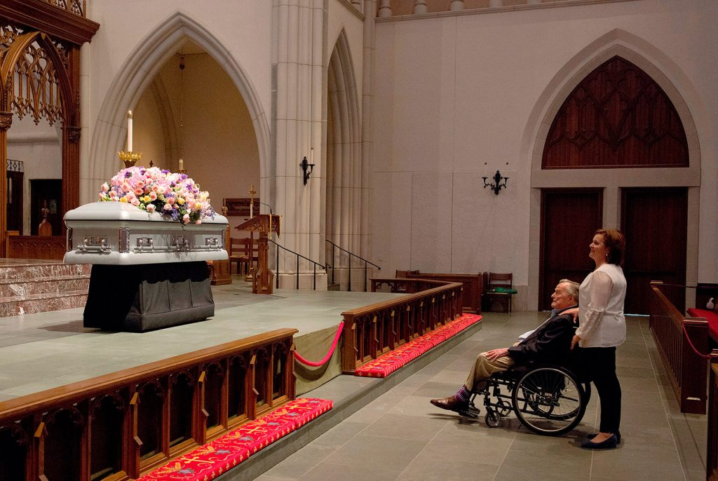 "Former President George H. W. Bush looks at the casket of his wife, former first lady Barbara Bush, with his daughter Dorothy ""Doro"" Bush Koch at St. Martin's Episcopal Church on Friday in Houston. Barbara Bush died on Tuesday, at the age of 92."