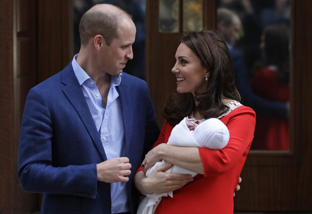 Britain's Prince William and Kate, Duchess of Cambridge pose for a photo with their newborn baby son as they leave the Lindo wing at St Mary's Hospital in London London, Monday. The Duchess of Cambridge gave birth Monday to a healthy baby boy — a third child for Kate and Prince William and fifth in line to the British throne.