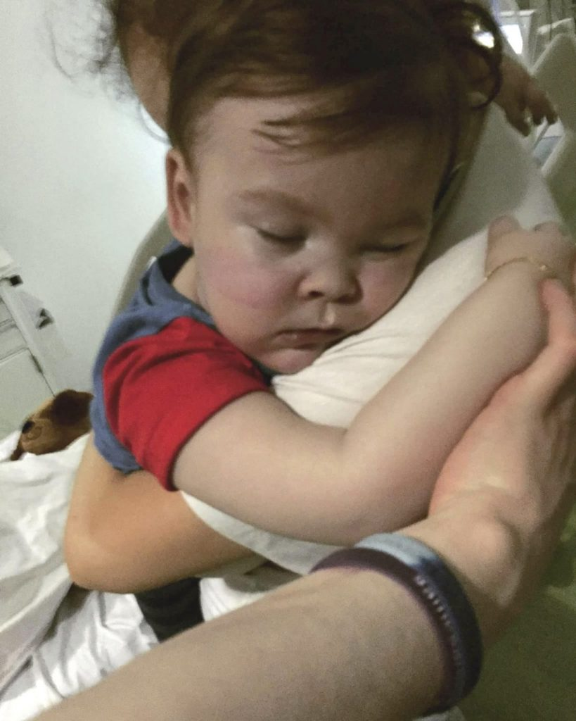Brain-damaged toddler Alfie Evans cuddles his mother, Kate James, at Alder Hey Hospital, Liverpool, England. The father of the boy said the child is surviving after being taken off life support, surprising doctors who had argued he should be allowed to die.