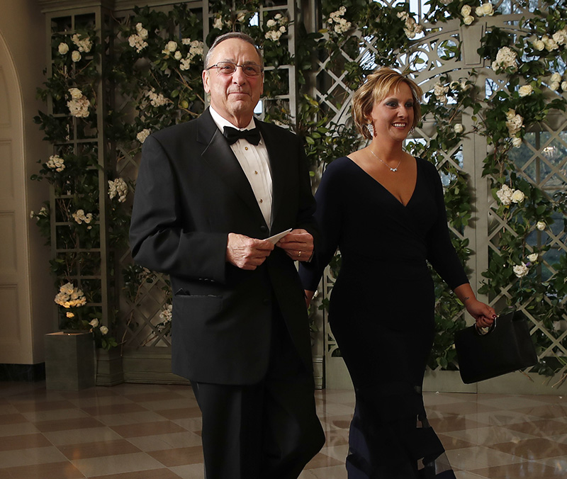 Gov. Paul LePage his daughter, Lauren,  arrive for the state dinner in honor of French President Emmanuel Macron on Tuesday.