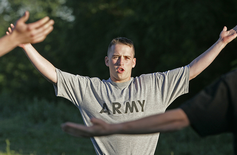 Army Pfc. Jon Schoenherr leads an exercise class outside an Army recruiting office in 2005.