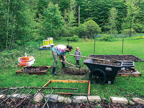 Fairfields of all ages are busy working in the raised bed garden plots. Photos courtesy of  Brittney Fairfield
