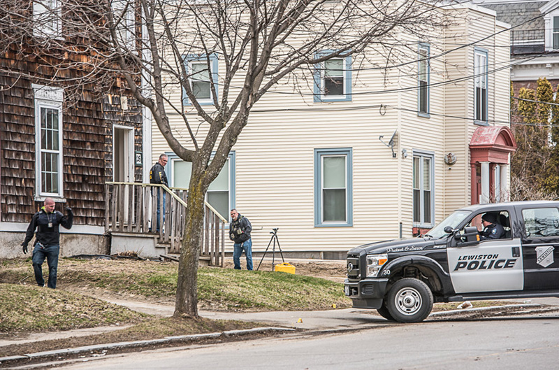 Police investigate a shooting near 126 College Street in Lewiston on Saturday afternoon.