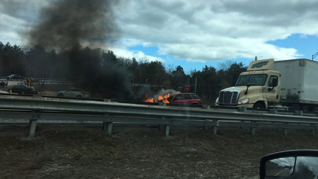 A fire in a car disrupted traffic on Interstate 295 in Freeport on Wednesday.