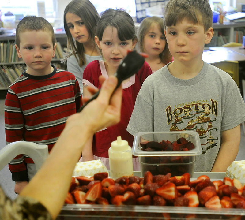 Mt. Vernon Elementary School first-graders line up for a bowl of strawberries and beets in 2015 in Linda Smith's classroom.