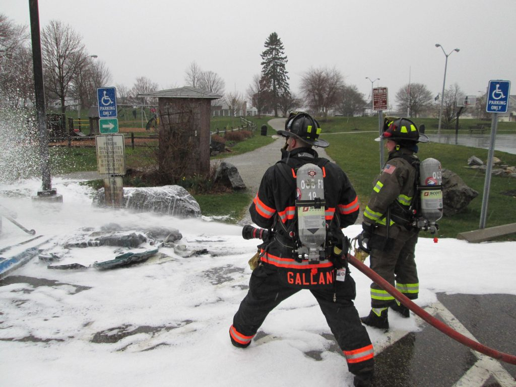 Firefighters extinguish a fire that ignited two portable toilets in an Old Orchard Beach park on Friday.