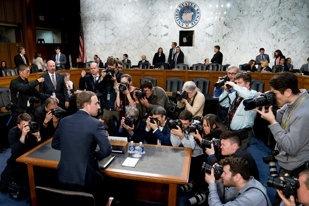 Facebook CEO Mark Zuckerberg returns from a break as he testifies before a joint hearing of the Senate Commerce and Judiciary committees on Capitol Hill on Tuesday.