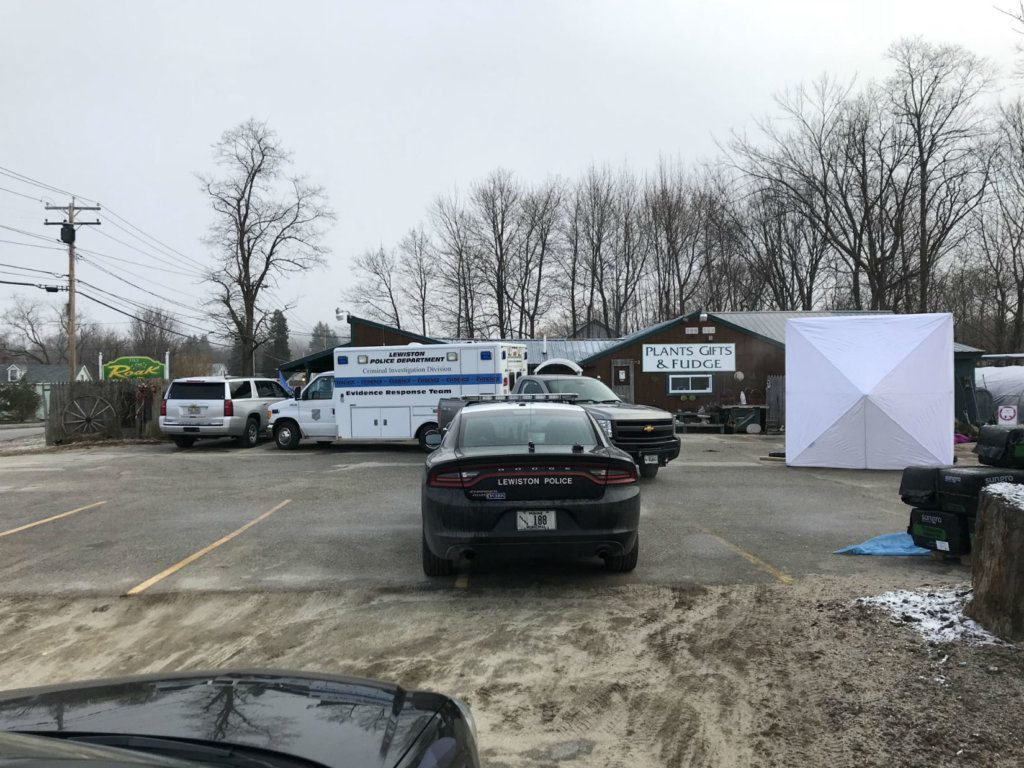 Lewiston Police are setting up several screens and blocking off the entire parking lot of Roak the Florist on Main Street after discovering the body of a woman near one of the greenhouses Wednesday morning.