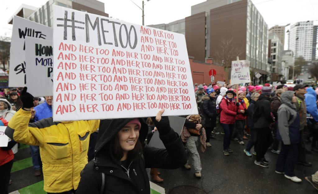 A marcher carries a sign with the popular Twitter hashtag #MeToo during a women's march in Seattle.