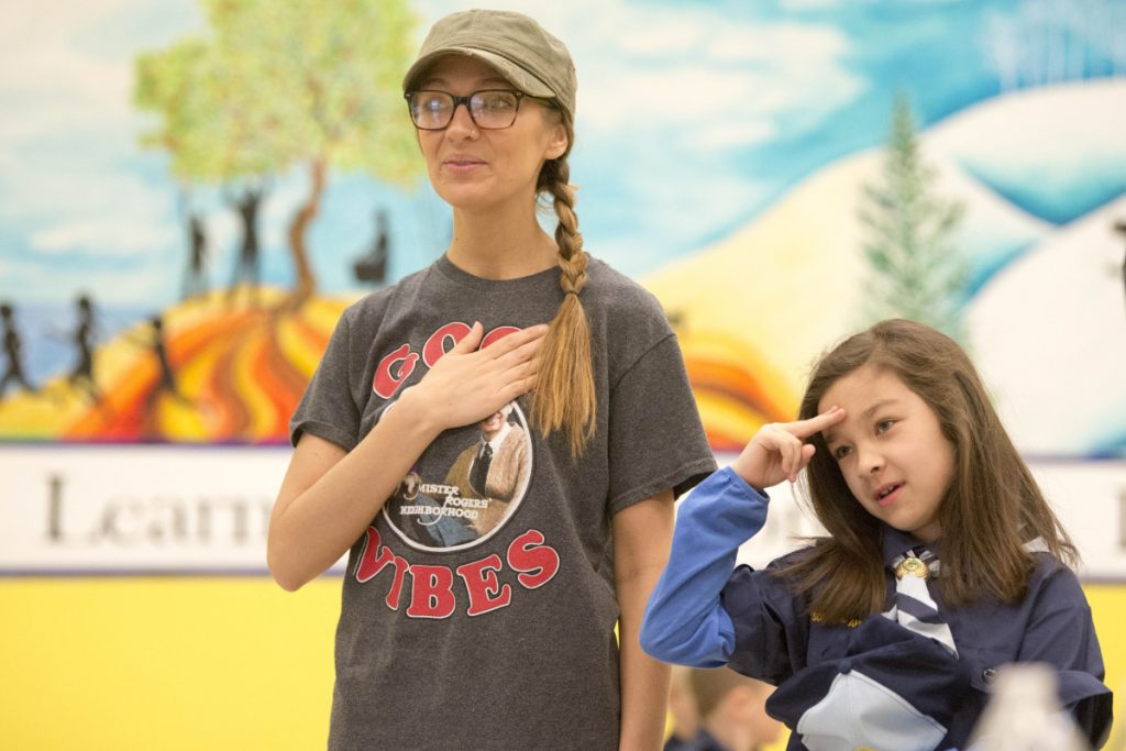 Natalie To, 8, says the Pledge of Allegiance with her mother Christina Ames during a Kennebec County Cub Scout pack meeting at Williams Elementary School in Oakland on Tuesday.
