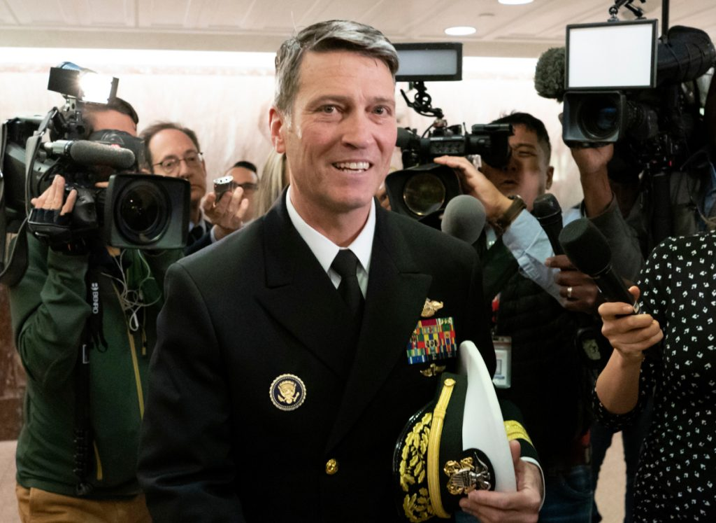 "Then-Rear Adm. Ronny Jackson, President Donald Trump's choice to be secretary of the Department of Veterans Affairs, leaves a Senate office building after meeting individually with some members of the committee that would vet him for the post, on Capitol Hill in Washington. Jackson withdrew from consideration as Veterans Affairs secretary. He said ""false allegations"" against him have become a distraction."