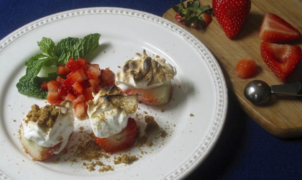 This spin on Baked Alaska uses fresh strawberries and crushed cookies instead of the traditional cake.