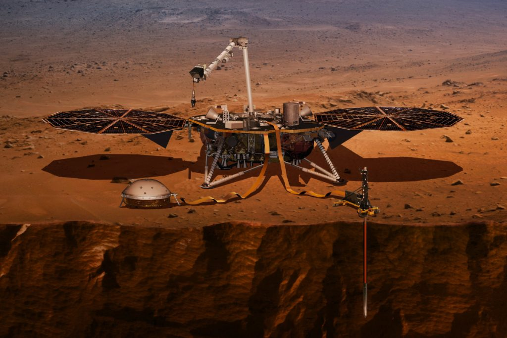 Illustration shows the InSight lander drilling into Mars. InSight is due to launch from Vandenberg Air Force Base on Saturday and land on Mars nearly seven months later.