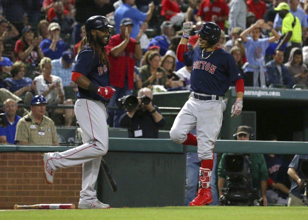 Boston's Hanley Ramirez, left, does a celebratory dance with Mookie Betts after Betts' solo home run in the sixth inning Friday night at Arlington, Texas.