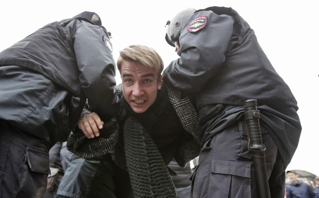 Police arrest a protester in St. Petersburg, Russia. Thousands gathered to protest the re-election of President Vladimir Putin, who won another term with 77 percent of the vote.