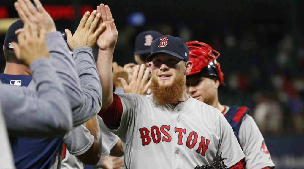 Craig Kimbrel celebrated with his Boston Red Sox teammates Saturday night after earning a save against the Texas Rangers – the 300th of his career – then was applauded with emotion in the clubhouse.