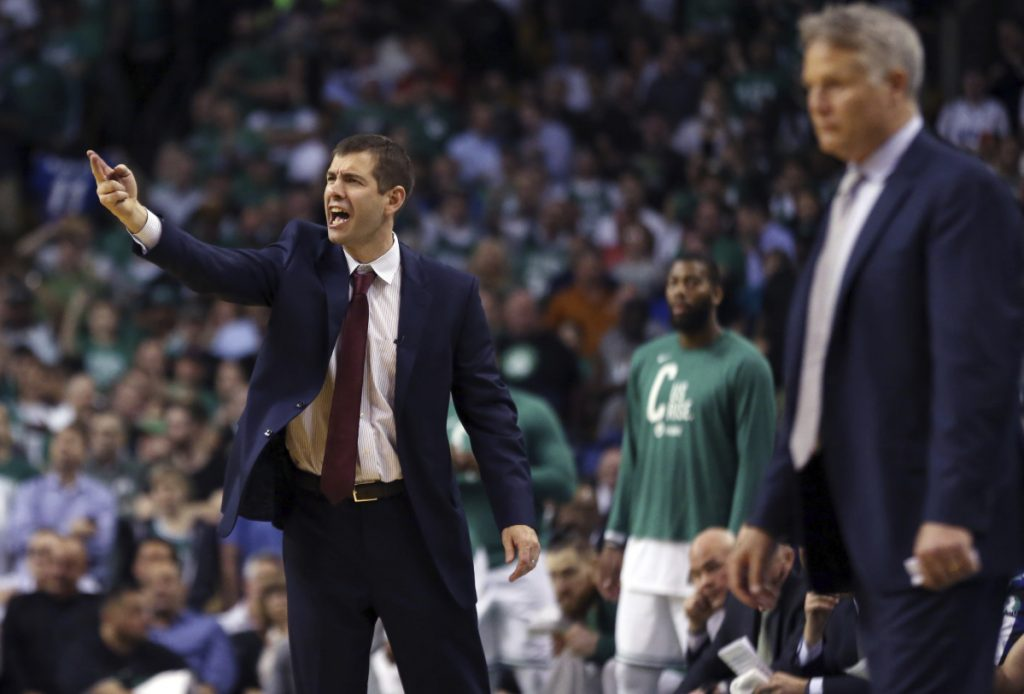 Boston Celtics coach Brad Stevens yells to his team as Philadelphia 76ers coach Brett Brown watches at right during the second half of Game 2 of an NBA basketball second-round playoff series, Thursday, May 3, 2018, in Boston. The Celtics won 108-103. (AP Photo/Elise Amendola)