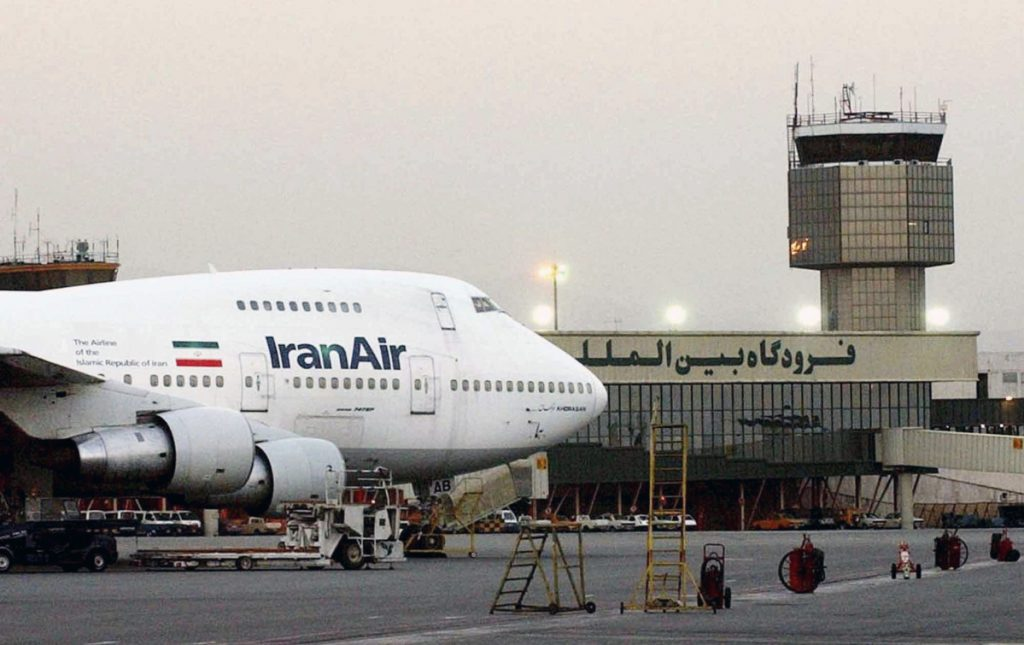 A Boeing 747 of the state carrier IranAir is seen  in 2003 at Mehrabad International Airport in Tehran.  Boeing owes Iran 110 new aircraft, but has slow-walked delivery because of uncertainty around the Iran nuclear deal. Associated Press/Hasan Sarbakhshian