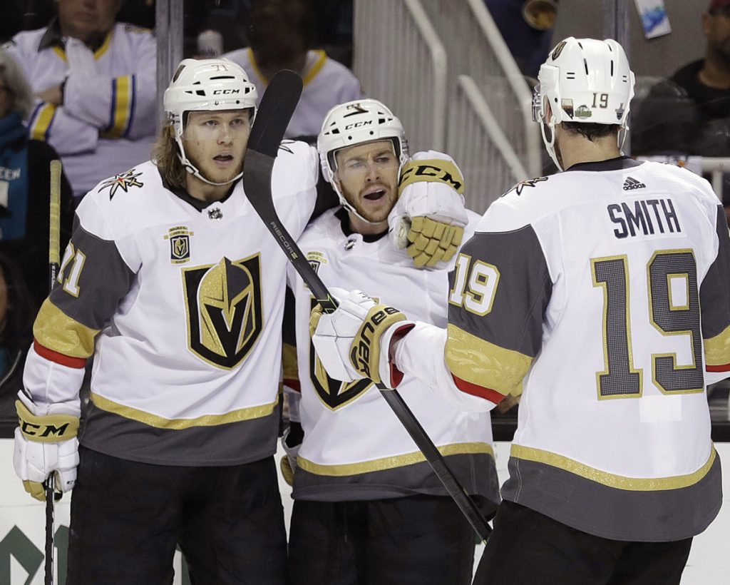 Jonathan Marchessault, center, celebrates his goal with Vegas teammates William Karlsson, left, and Reilly Smith during the Golden Knights' 3-0 win Sunday over Nashville.