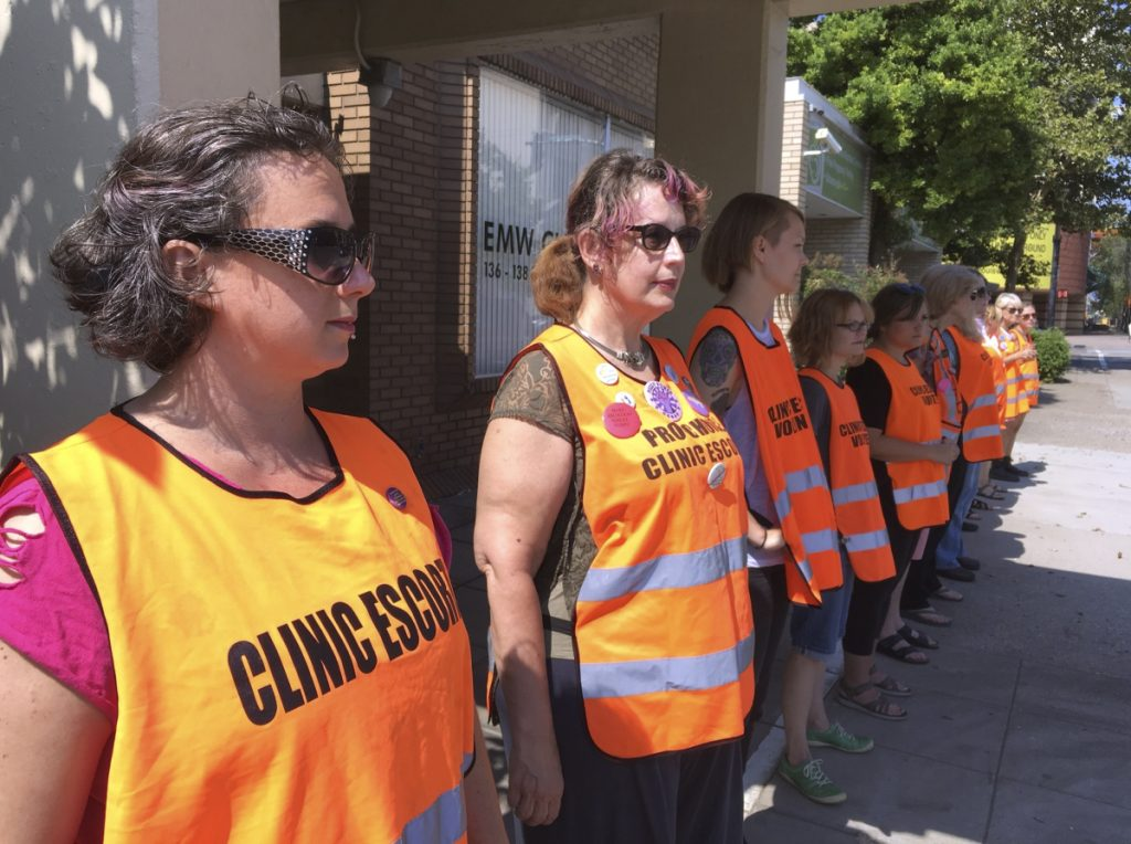 Escort volunteers line up outside the EMW Women's Surgical Center in Louisville, Ky., last July. A federal judge established a buffer zone outside the clinic to keep anti-abortion protesters from assembling in front of the entrance, after at least 10 protesters were arrested for blocking it earlier in the month.