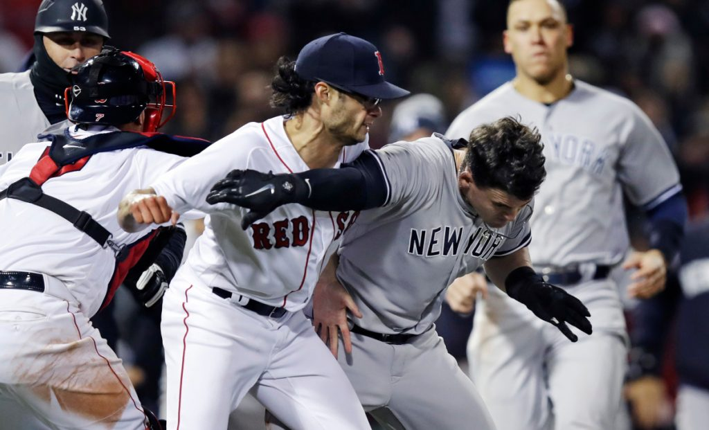 New York Yankees' Tyler Austin, right, scuffles with Boston Red Sox relief pitcher Joe Kelly, after being hit by a pitch during a game at Fenway Park on April 11. (AP Photo/Charles Krupa)