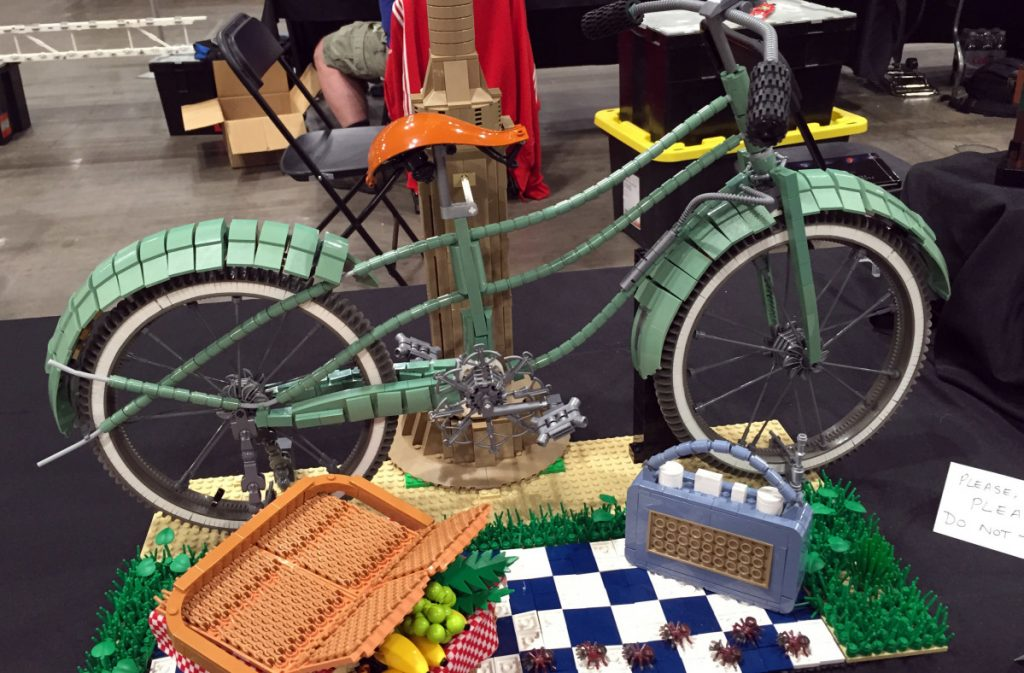 A Lego-style picnic, replete with ants entering in the foreground, is laid out at Brickworld Chicago last June. The event attracts Lego fans from around the world.