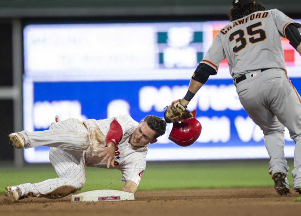 Scott Kingery of the Philadelphia Phillies is safe at second base with a steal Monday night as shortstop Brandon Crawford of the San Francisco Giants is late with the tag in the fourth inning of the Phils' 11-0 victory.