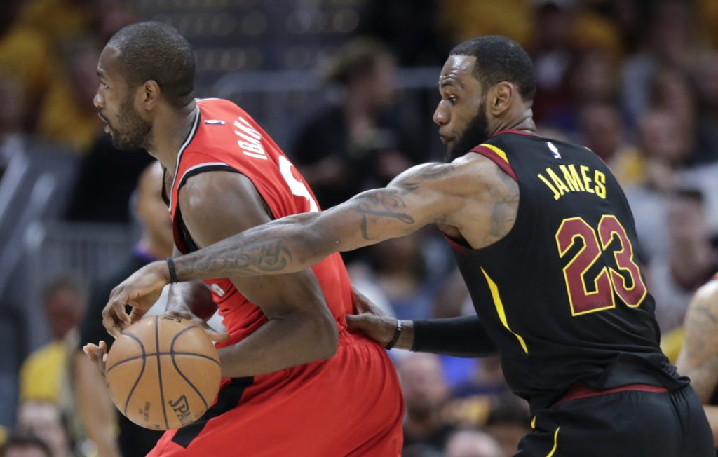 Cleveland's LeBron James strips the ball from Toronto's Serge Ibaka in the first half of Game 4 of their second-round playoff series Monday in Cleveland.